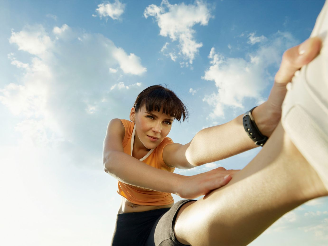 woman stretching her leg before going out for a run